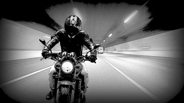image of biker with jacket on motorcycle
